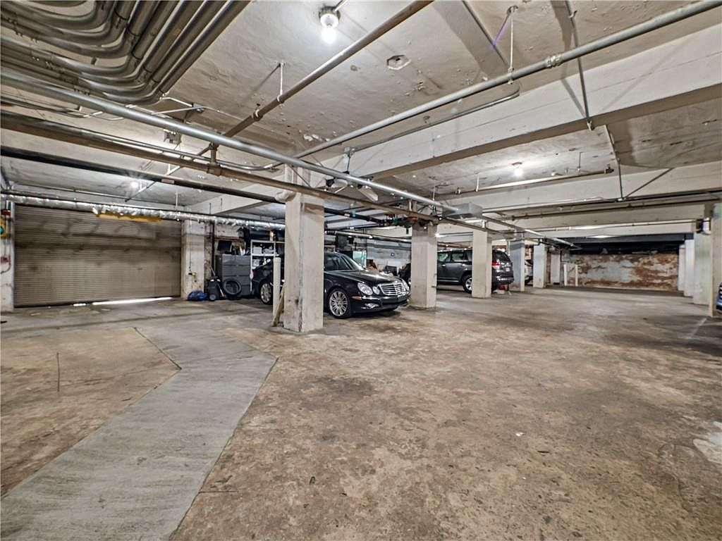A long garage with nice cars in it.