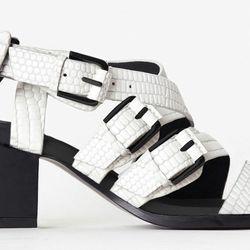"<b>3.1 Phillip Lim</b> Bee Sandal in Optic White, <a href=""https://www.31philliplim.com/shop/womens/footwear/795/color/145"">$550</a>"