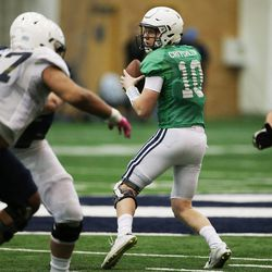 Brigham Young Cougars quarterback Joe Critchlow (10) sets to throw during an intersquad scrimmage in Provo on Friday, March 23, 2018.
