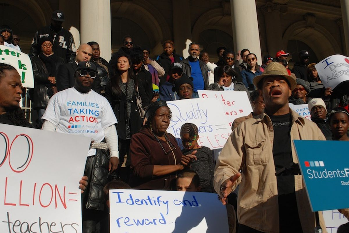 Keoni Wright, right, one of the parents expected to file a lawsuit against job protections for teachers. Wright spoke at a StudentsFirstNY rally outside City Hall in 2012.