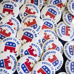 Republican buttons sit on a booth during the beginning campaigning at Timpview High School Provo on Saturday, June 17, 2017.