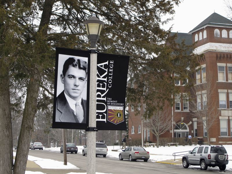 A banner noting the centennial of Ronald Reagan's birth hangs on the campus of his alma mater, Eureka College in Eureka, Ill., in 2011.