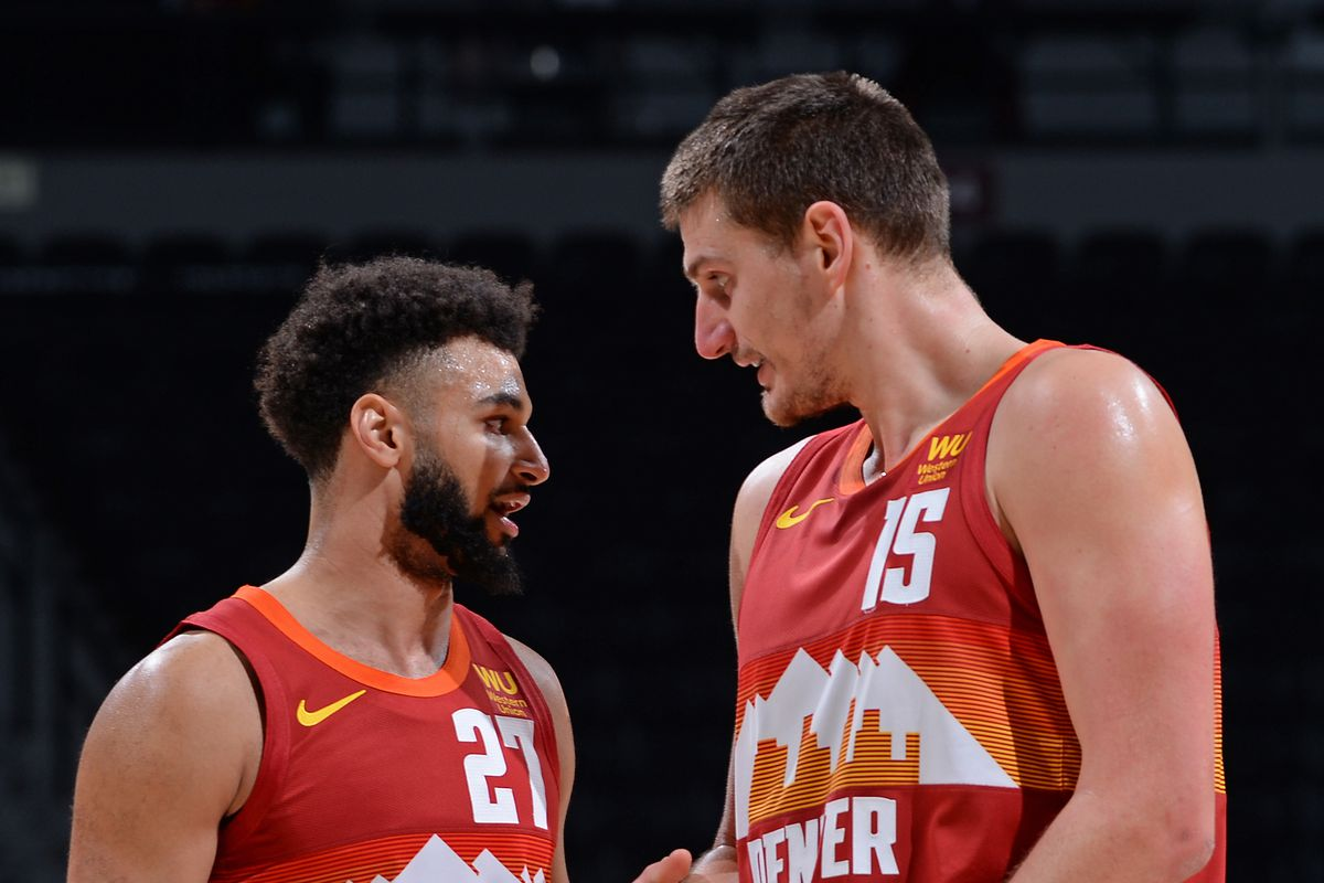 Jamal Murray and Nikola Jokic of the Denver Nuggets talk against the LA Clippers on December 25, 2020 at Ball Arena in Denver, Colorado.