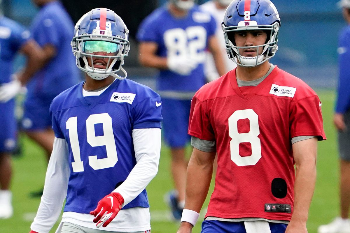 New York Giants wide receiver Kenny Golladay (19) and quarterback Daniel Jones (8) walk on the field together during OTA practice at the Quest Diagnostics Training Center on Friday, June 4, 2021, in East Rutherford. Giants Ota Practice