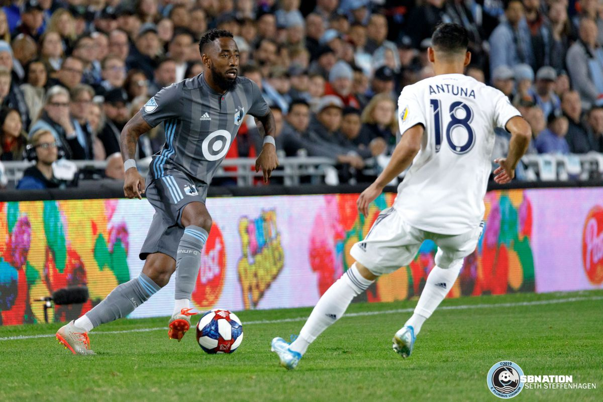 October 20, 2019 - Saint Paul, Minnesota, United States - Minnesota United defender Romain Metanire (19) looks to dribble by LA Galaxy midfielder Uriel Antuna (18) during the first round playoff match at Allianz Field.