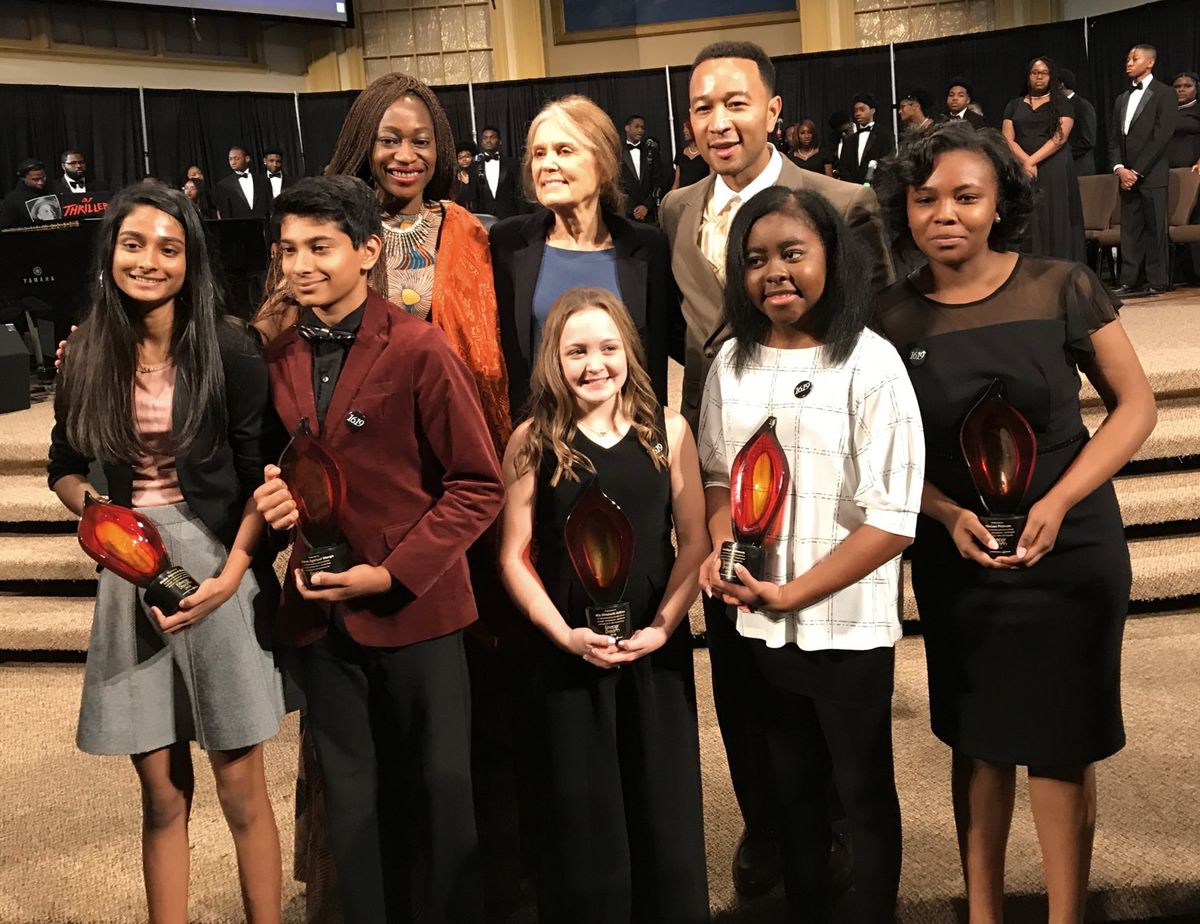 Marissa Pittman, far right, with other student winners (in front) and the National Civil Rights Museum's honorees for Freedom Award (in back from left) Hafsat Abiola, Gloria Steinem, and John Legend.