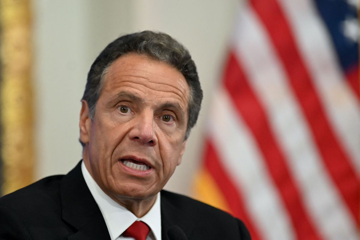 In this file photo taken on May 26, 2020 Governor of New York Andrew Cuomo speaks during a press conference at the New York Stock Exchange (NYSE) at Wall Street in New York City.