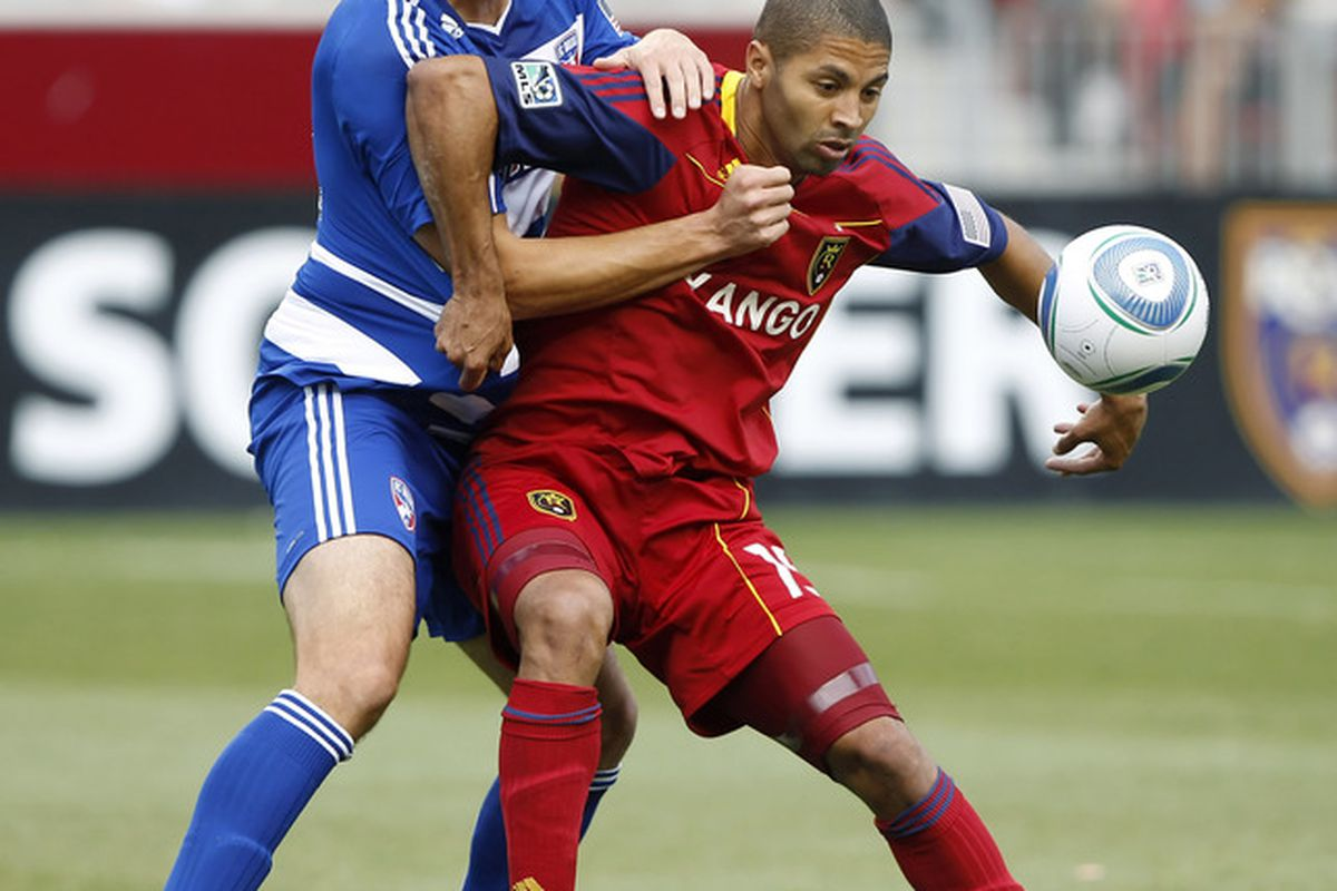SANDY, UT - JULY 9: Alvaro Saborio #15 of Real Salt Lake and George John #14 of FC Dallas fight for the ball during the first half of an MLS soccer game July 9, 2011 at Rio Tinto Stadium in Sandy, Utah. (Photo by George Frey/Getty Images)