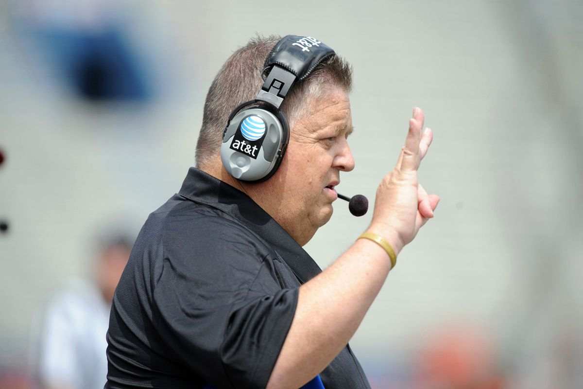 Apr 28, 2012; Lawrence, KS, USA; Kansas Jayhawks head coach Charlie Weis watches during the first half of the Spring Game at Memorial Stadium. Mandatory Credit: John Rieger-US PRESSWIRE