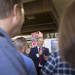 Provo Mayor John Curtis stands on a platform to hear his crowd and answer questions while campaigning for the vote of Republican delegates at Timpview High School in Provo on Saturday, June 17, 2017.