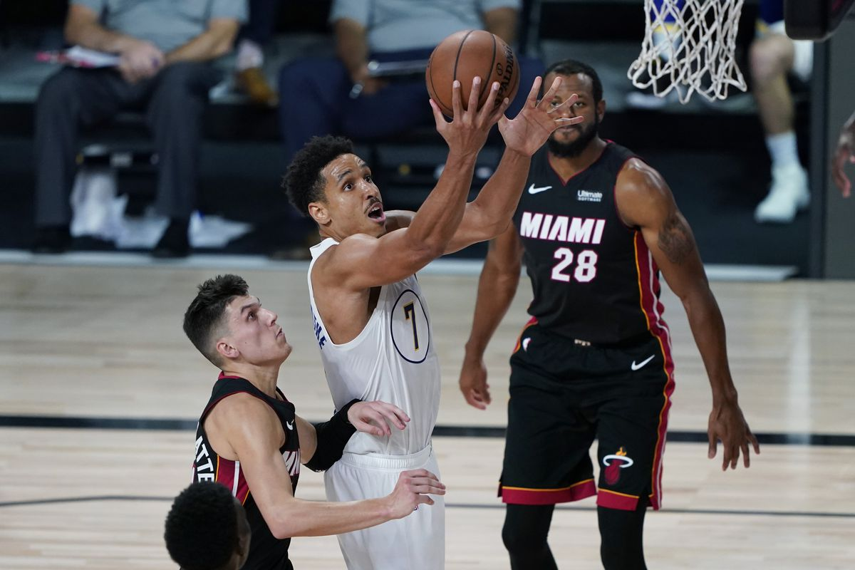 Malcolm Brogdon of the Indiana Pacers drives to the basket past Tyler Herro of the Miami Heat during the second half of Game Three of the first round of the playoffs at the AdventHealth Arena at the ESPN Wide World Of Sports Complex on August 22, 2020 in Lake Buena Vista, Florida.