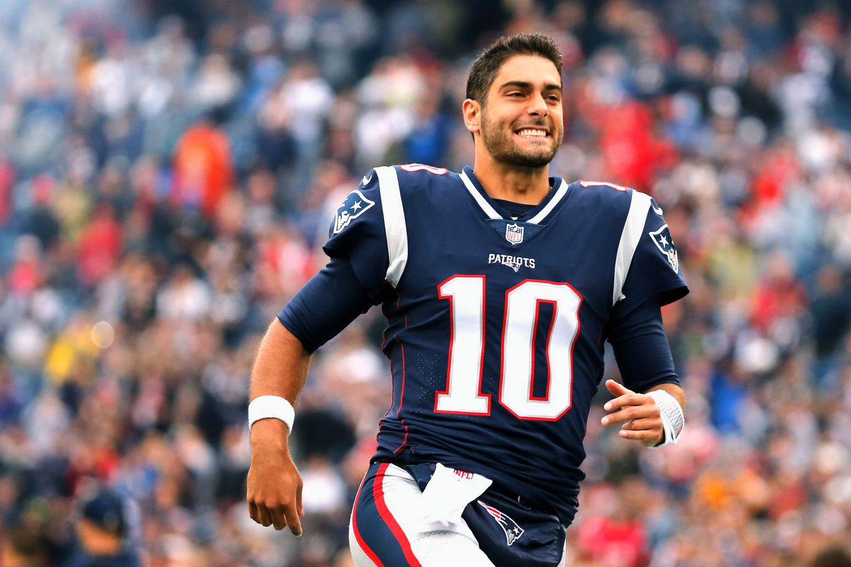 Jimmy Garoppolo smiling in a Patriots uniform