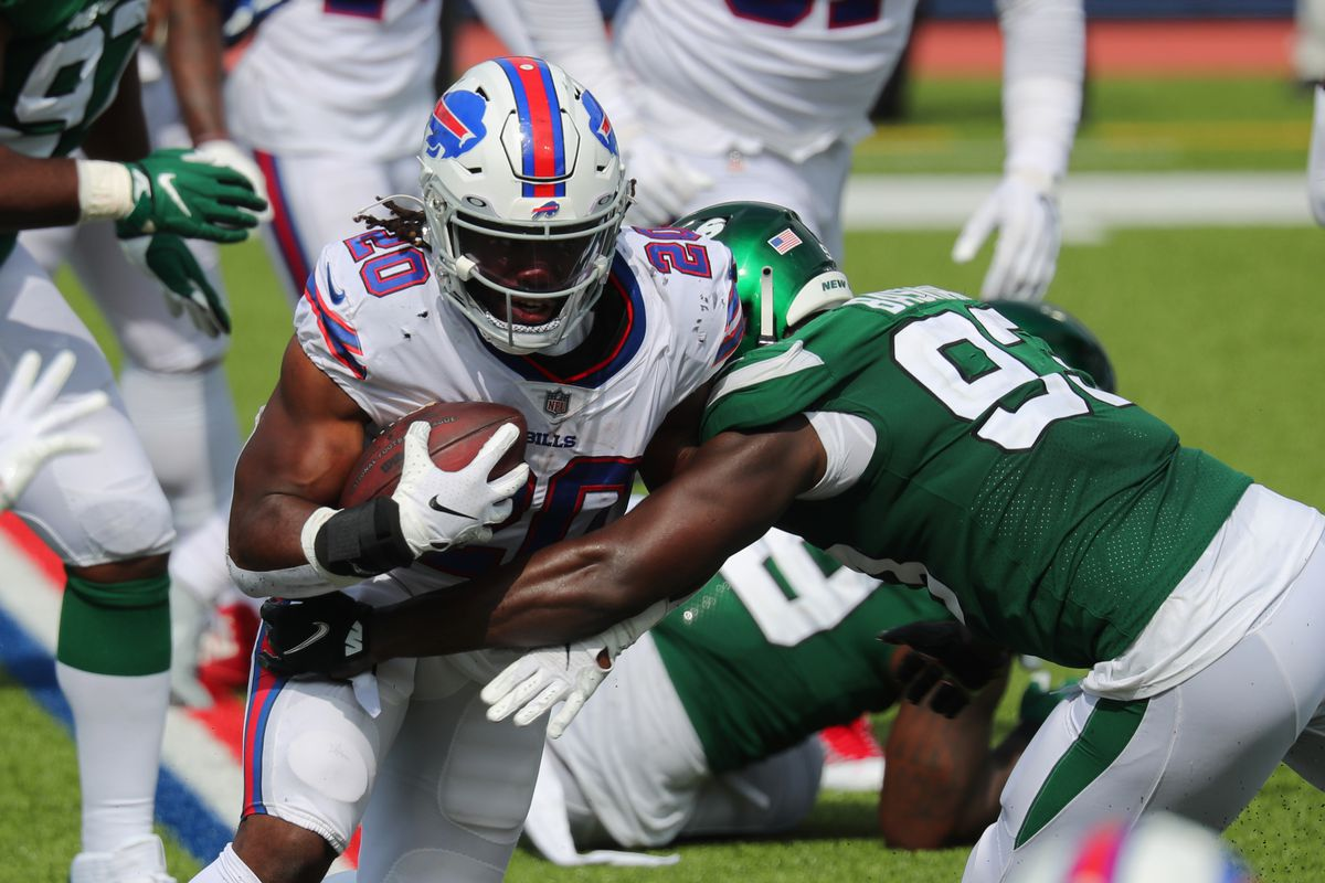 Tarell Basham of the New York Jets makes a tackle on Zack Moss of the Buffalo Bills as he runs the ball during the second half at Bills Stadium on September 13, 2020 in Orchard Park, New York. Bills beat the Jets 27 to 17.