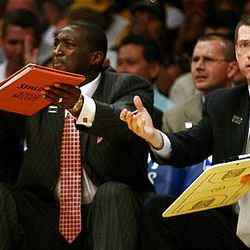 Utah coaches Tyrone Corbin, center, and Scott Layden, right, plead with the refs as the Utah Jazz and the Los Angeles Lakers play.