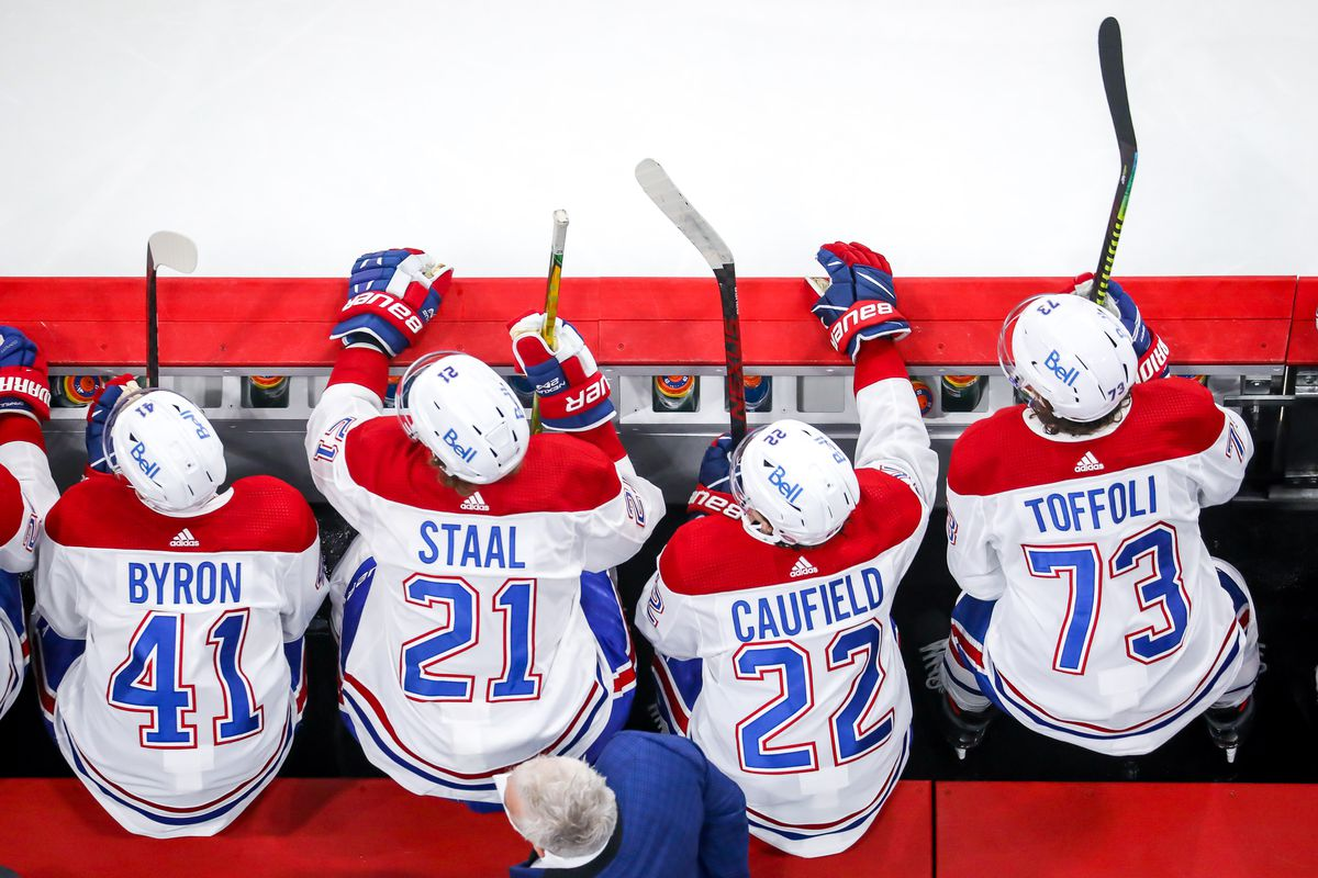 Paul Byron #41, Eric Staal #21, Cole Caufield #22 and Tyler Toffoli #73 of the Montreal Canadiens look on from the bench during third period action against the Winnipeg Jets in Game Two of the Second Round of the 2021 Stanley Cup Playoffs at the Bell MTS Place on June 4, 2021 in Winnipeg, Manitoba, Canada.