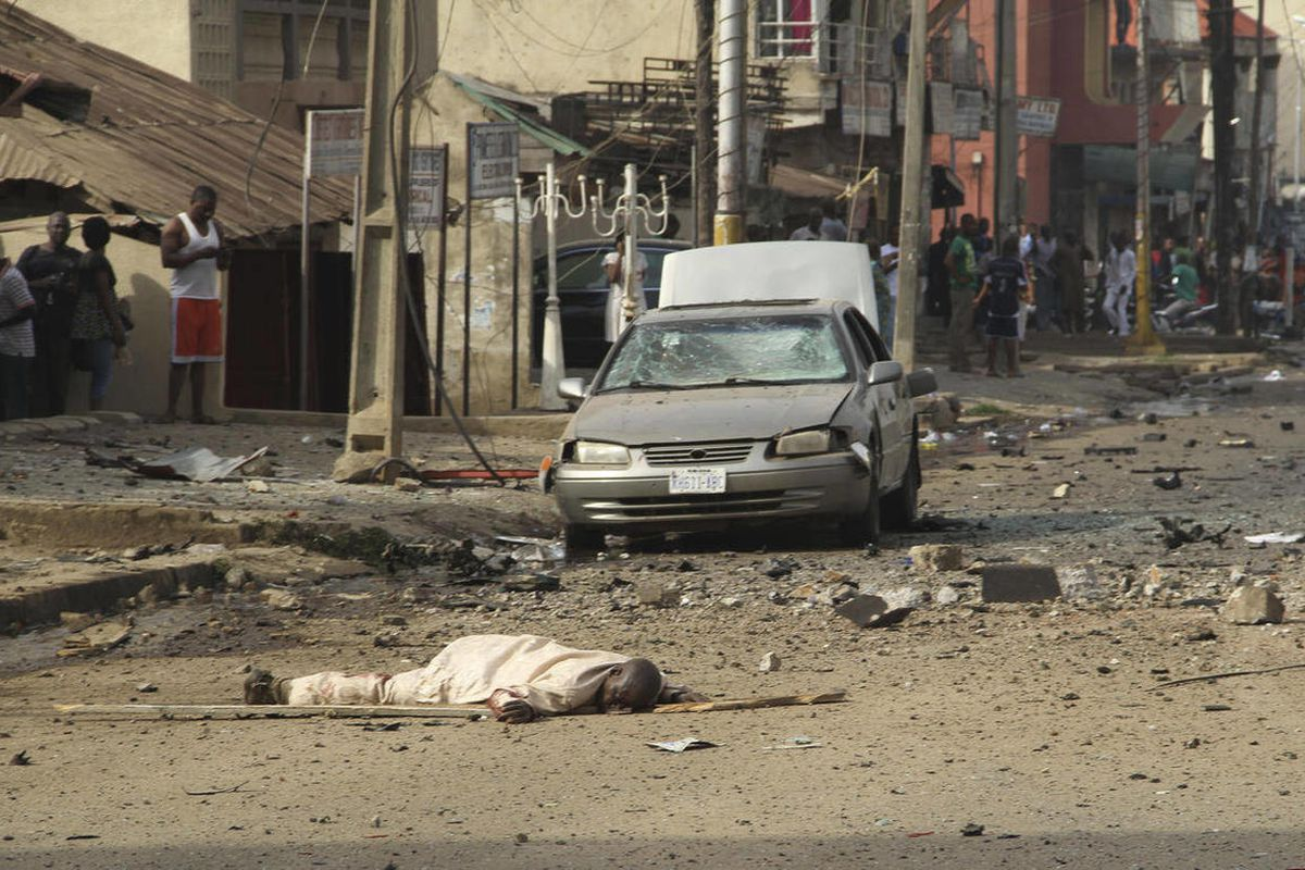 A body is seen at the site of a bomb explosion at a road in Kaduna, Nigeria on Sunday, April 8, 2012. An explosion struck the city of Kaduna in central Nigeria  on Sunday  that has seen hundreds killed in religious and ethnic violence in recent years, cau