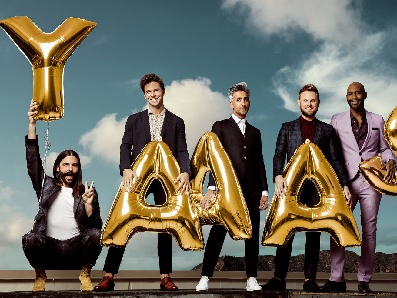 """The cast of Netflix's """"Queer Eye"""" each holding an inflatable letter, spelling out """"Yaaas."""""""