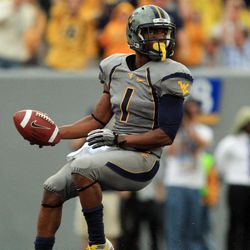 West Virginia wide receiver Tavon Austin (1) crosses the goal line for a touchdown during an NCAA college football game against Maryland in Morgantown, W.Va., Saturday, Sept. 22, 2012.