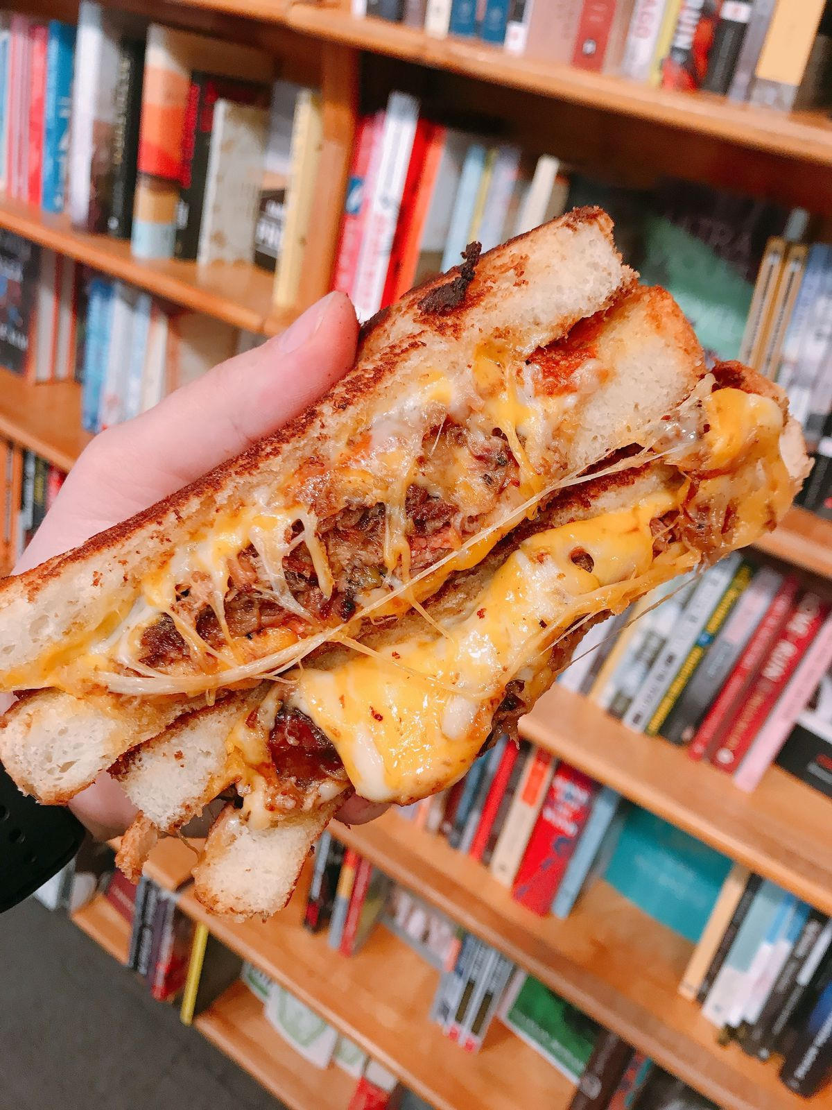 A Fedpig Melt has smoked pulled pork, melted cheddar and jack cheeses, and cherry pepper aioli