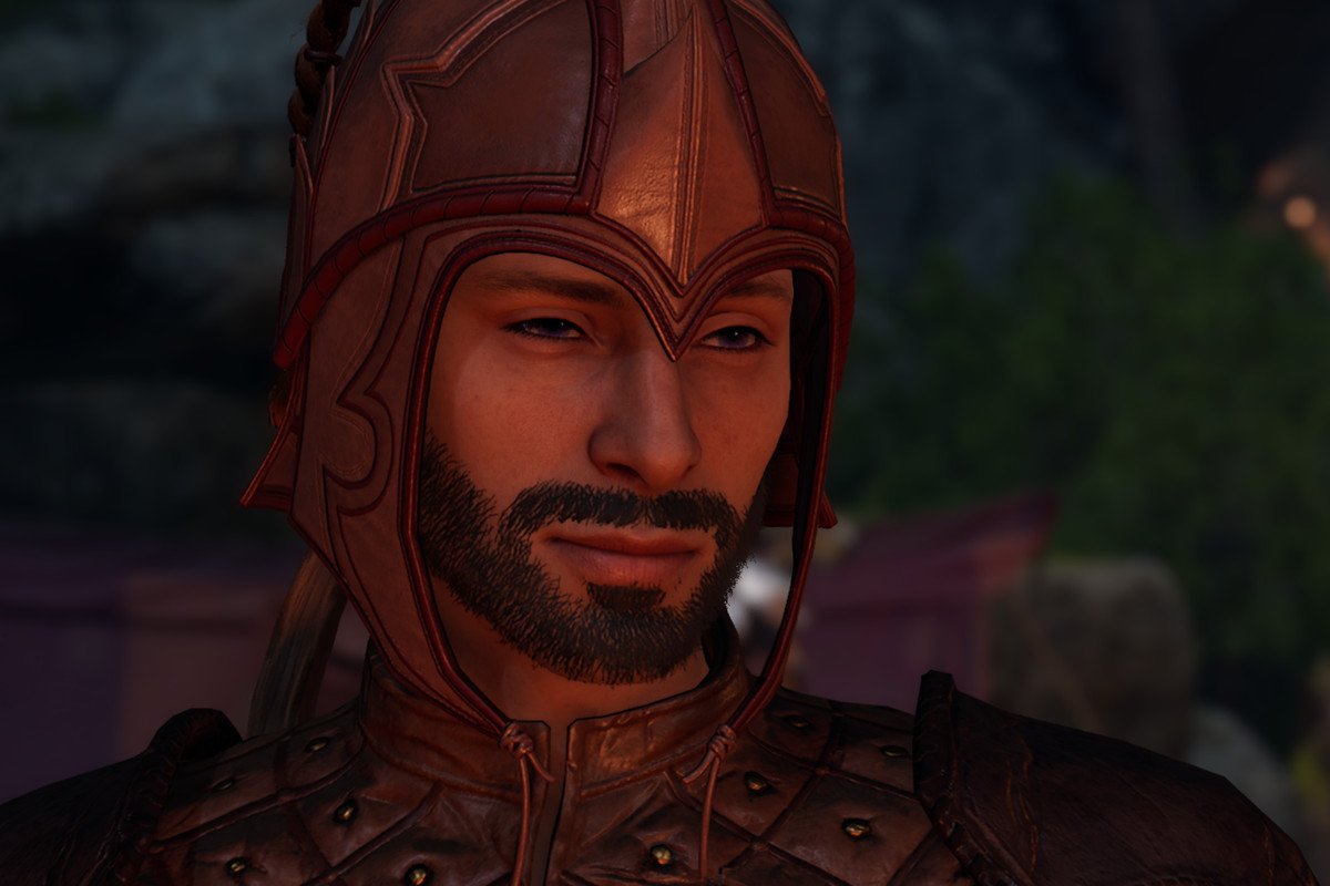 A character stares at the fire in Baldur's Gate 3
