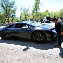 Adrian Zamarripa gently touches the front of Jeremy Neves' Lamborghini Huracan in Ogden on Tuesday, May 5, 2020. Adrian, who is 5, tried to drive his parents' car to California to get his own Lamborghini on Monday, He was stopped by the Utah Highway Patrol just a few miles from his home.