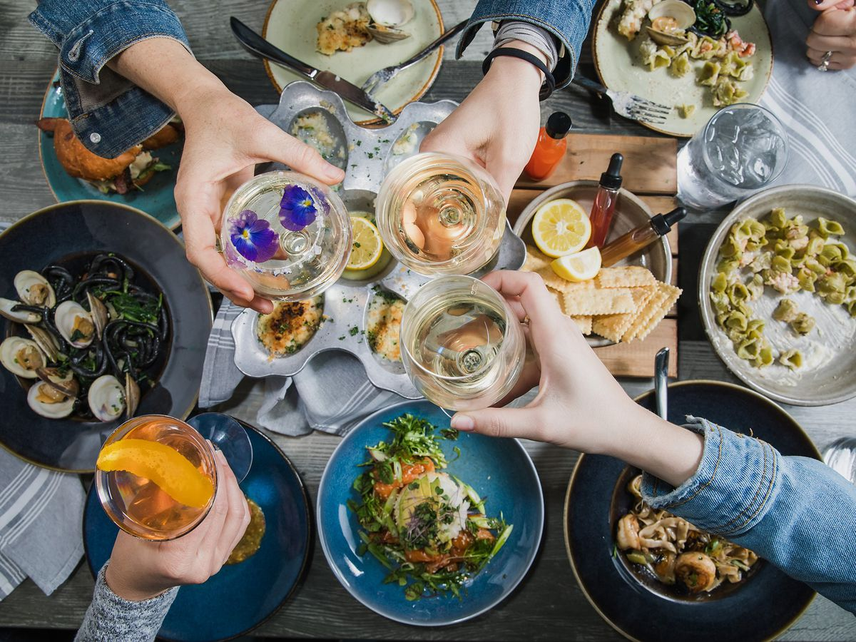 overhead shot of plates full of seafood