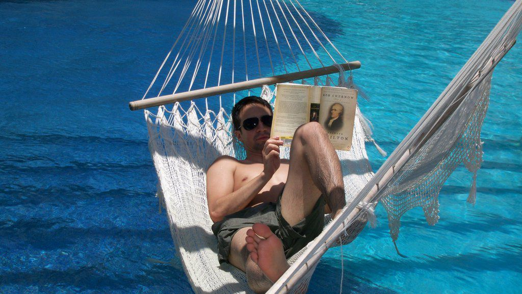 """Lin-Manuel Miranda, on a vacation some years ago, reading the book that would inspire his musical, """"Hamilton."""" 