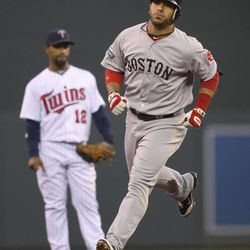 Boston Red Sox's Mike Aviles rounds the bases after his three-run home run in the second inning against the Minnesota Twins in a baseball game Wednesday, April 25, 2012, in Minneapolis.