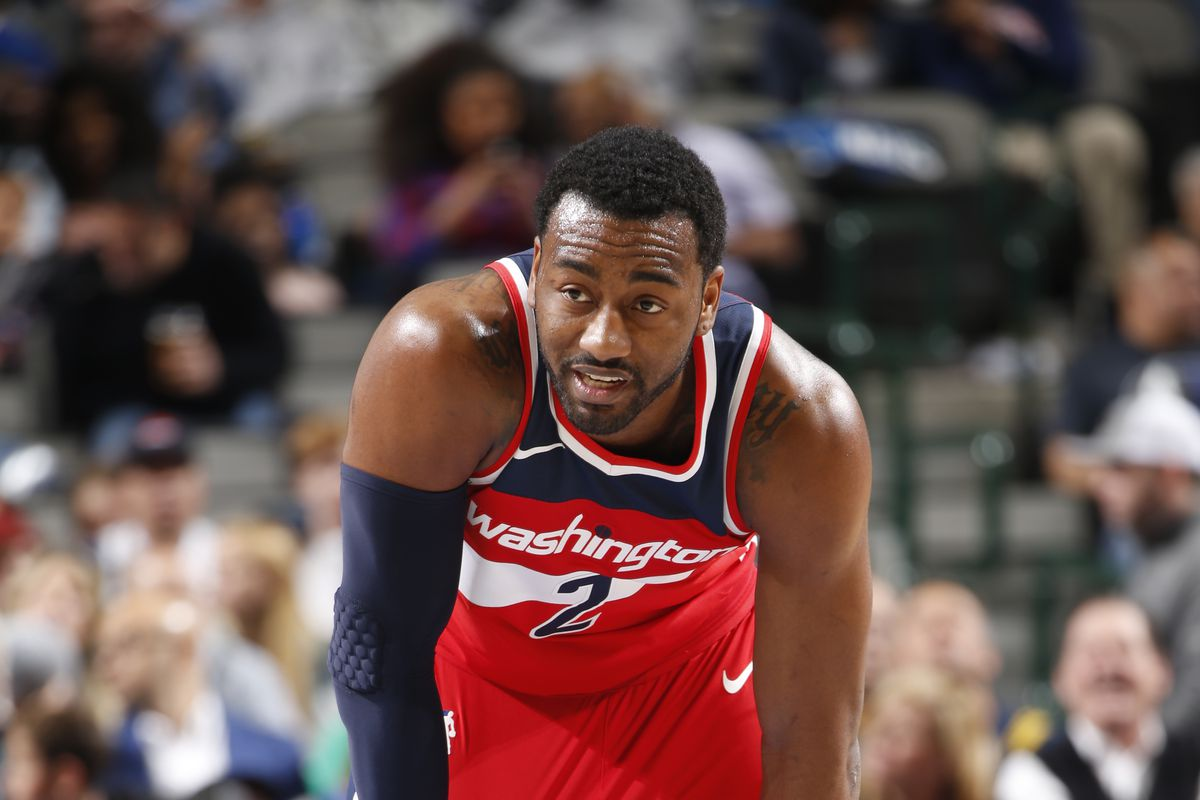 John Wall with his hands on his knees