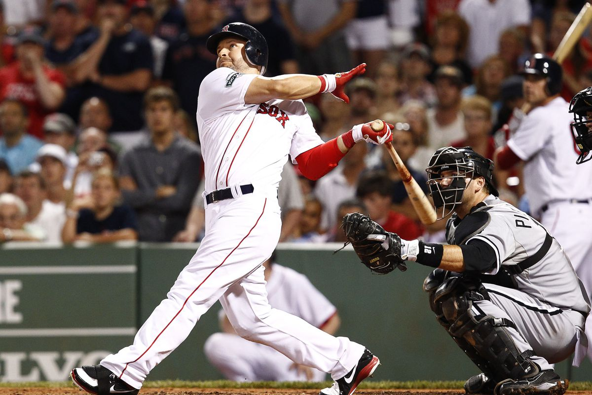 Boston Red Sox right fielder Cody Ross (7) hits a walk-off home run Chicago White Sox at Fenway Park.  He wasn't the first player to clear the LF Wall either, that honor goes to Hugh Bradley. Mandatory Credit: Mark L. Baer-US PRESSWIRE