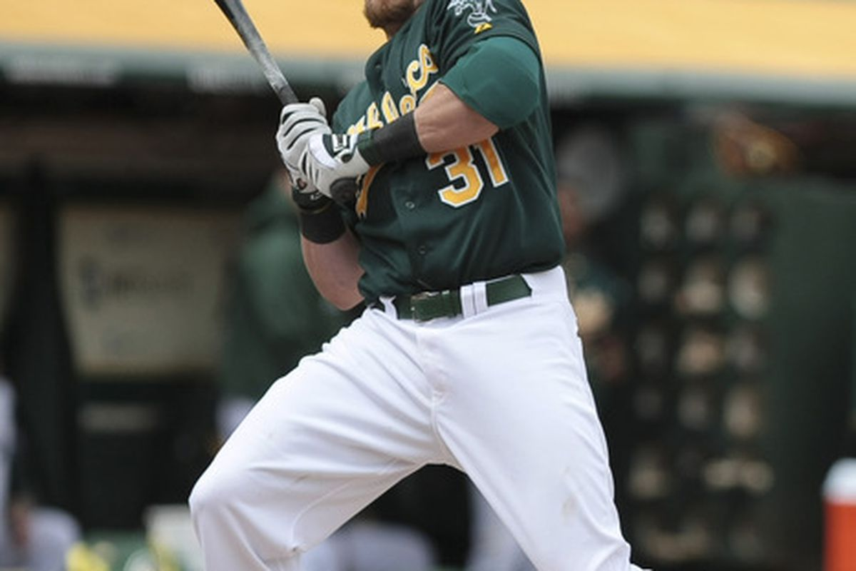 April 11, 2012; Oakland, CA, USA; Oakland Athletics left fielder Jonny Gomes (31) avoids being hit in the face before being walked during the sixth inning against the Kansas City Royals at O.co Coliseum. Mandatory Credit: Kelley L Cox-US PRESSWIRE