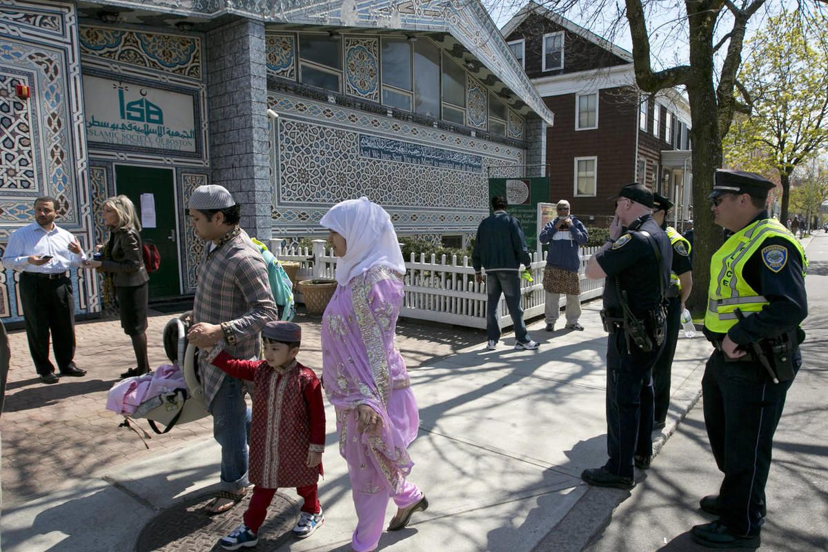 Police stand by as Muslims leave the Islamic Society of Boston mosque, Friday, April 26, 2013, in Cambridge, Mass. Leaders of the Islamic Society of Boston said Tamerlan Tsarnaev occasionally attended Friday prayers, but had protested the community's mode