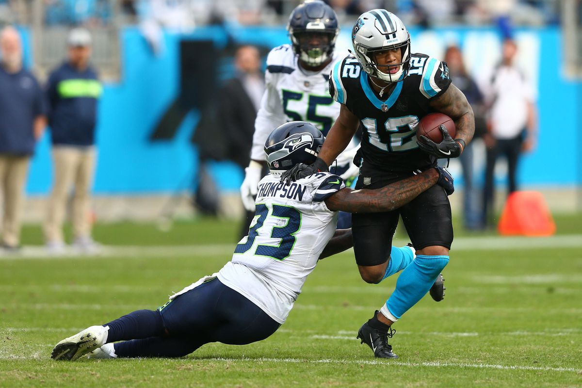 Carolina Panthers wide receiver DJ Moore runs after a reception in the fourth quarter against Seattle Seahawks free safety Tedric Thompson at Bank of America Stadium.