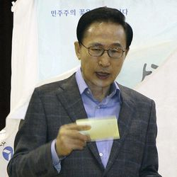 South Korean Presidential Lee Myung-bak exits a booth after writing down a candidate to cast his ballot in the parliamentary elections at a polling station in Seoul, South Korea, on Wednesday, April 11, 2012.