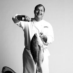 """Dave Pasternack of Esca, trying to get a sea bass drunk. (<a href=""""http://www.melaniedunea.com/photographer/portfolio/projects.php?id_project=3"""" rel=""""nofollow"""">photo</a>)"""