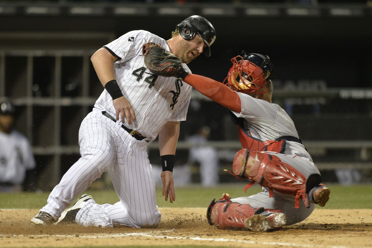 Adam Dunn out at home trying to score from first on a double