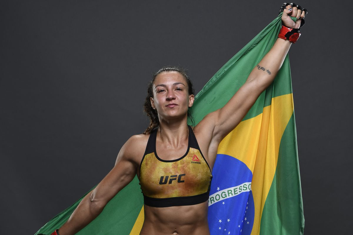 Amanda Ribas of Brazil poses for a portrait backstage with her team after her victory during the UFC Fight Night event on March 14, 2020 in Brasilia, Brazil.
