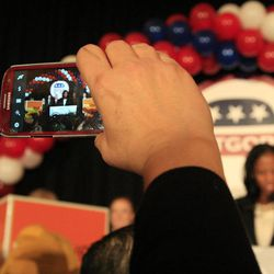 A supporter records video of Mia Love, U.S. congresswoman-elect, speaking at Hilton Salt Lake City Center on Tuesday, Nov. 4, 2014, in Salt Lake City.