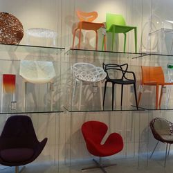 Between the stark white bird's nest chair or the groovy red one below, standing doesn't seem to be an option here.