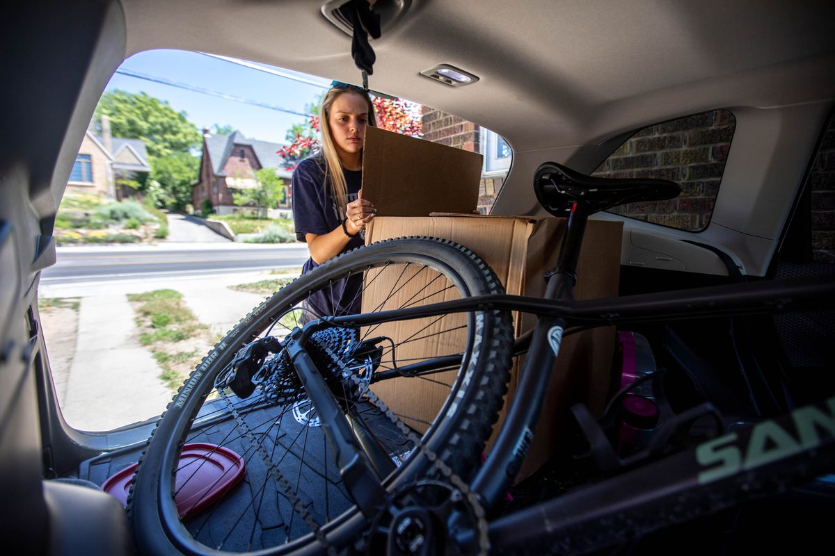 Sadie Texer removes items from her car at her new home in Salt Lake City on Saturday June 12, 2021.