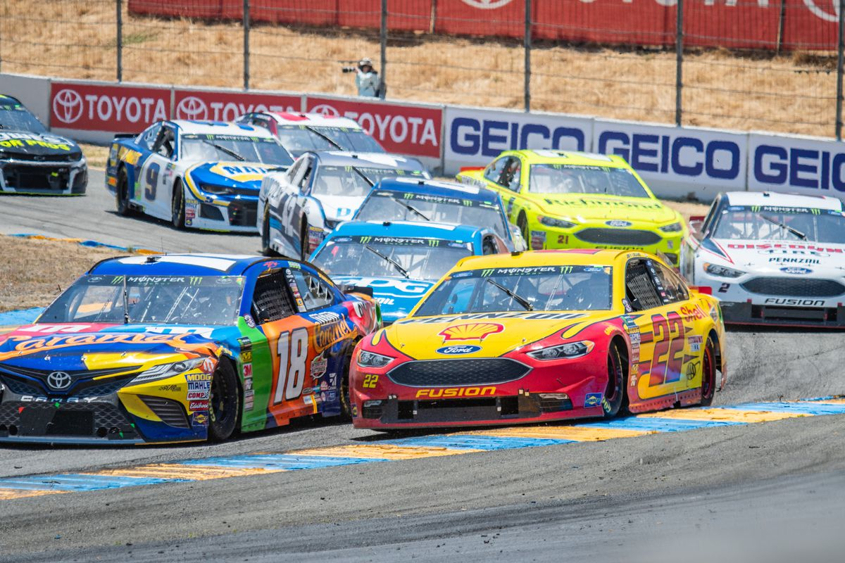 Kyle Busch, driving the (18) Toyota for Joe Gibbs Racing and Joey Logano, driving the (22) Ford for Team Penske head up the 2nd wave of cars around turn 4a after a restart on Sunday, June 24, 2018 at the NASCA Cup Series Toyota/Save Mart 350 Race at Sonoma Raceway, Sonoma, CA.