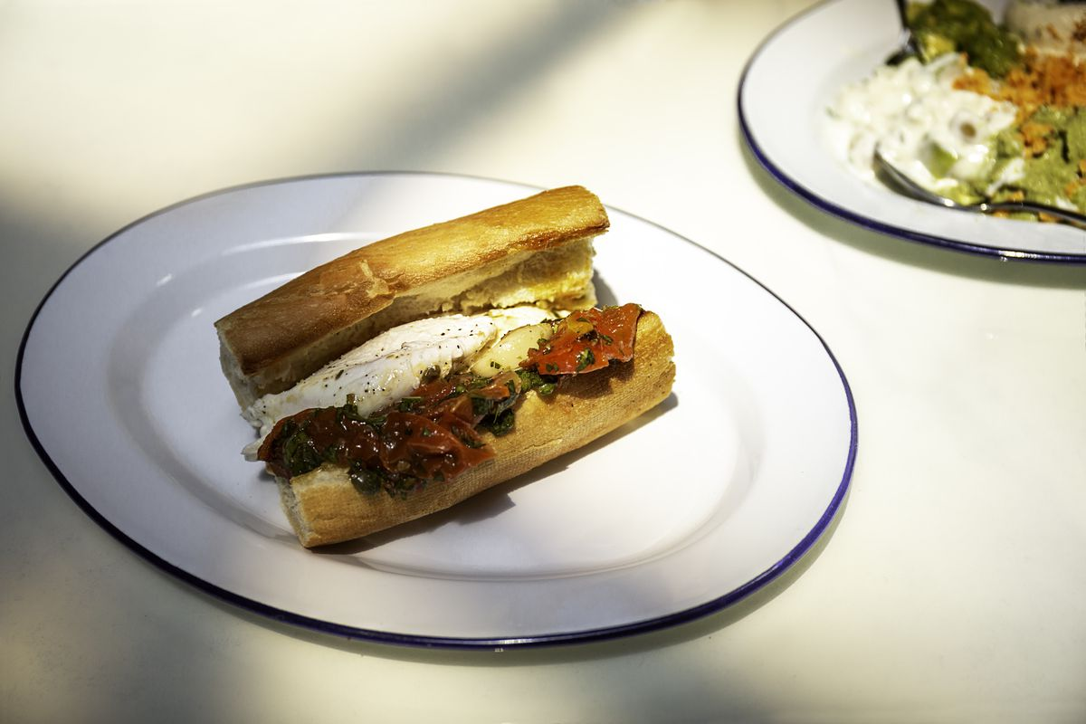 The tomato and burrata specialty sandwich on a toasted baguette at Leven