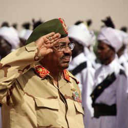 """Sudanese President Omar al-Bashir salutes during a visit to al-Obeid, North Kordofan, Sudan, Thursday, April 19, 2012. The Arab League said Thursday it would hold an emergency meeting over the increasing violence between Sudan and South Sudan. Sudan President Omar al-Bashir on Wednesday threatened to topple the South Sudan government after accusing the south of trying to take down his Khartoum-based government. Al-Bashir continued his hardline rhetoric on Thursday in an address to a """"popular defense"""" brigade headed to the Heglig area. The ceremony was held in al-Obeid, in northern Kordofan."""