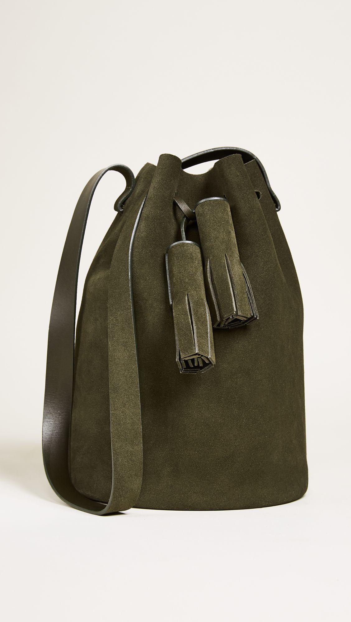 A green suede bucket bag