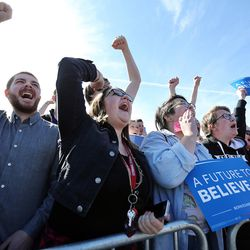 Crowds cheer as Democratic presidential candidate and Vermont Sen. Bernie Sanders gives a speech to supporters at This is the Place Heritage Park in Salt Lake City, Friday, March 18, 2016.
