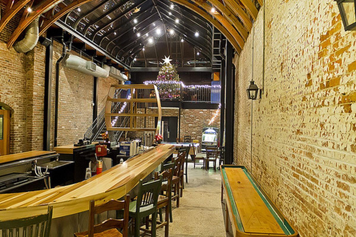 Paulie's paninis and a quiet atmosphere make the OKRA Charity Saloon an option for solo travelers looking for sustenance downtown