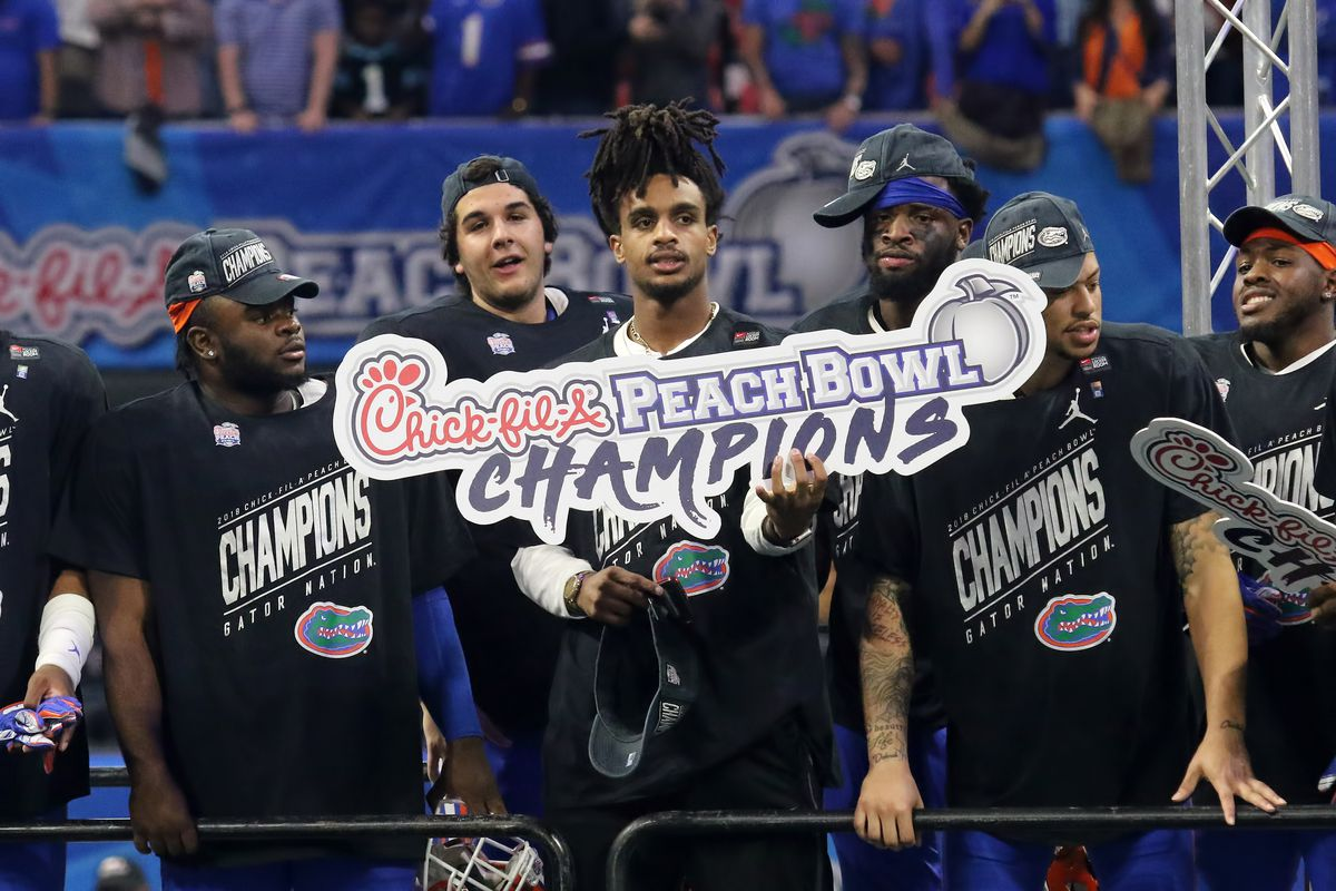 Florida Gators celebrate winning the Peach Bowl between the Florida Gators and the Michigan Wolverines on December 29, 2018 at Mercedes-Benz Stadium in Atlanta, Georgia.