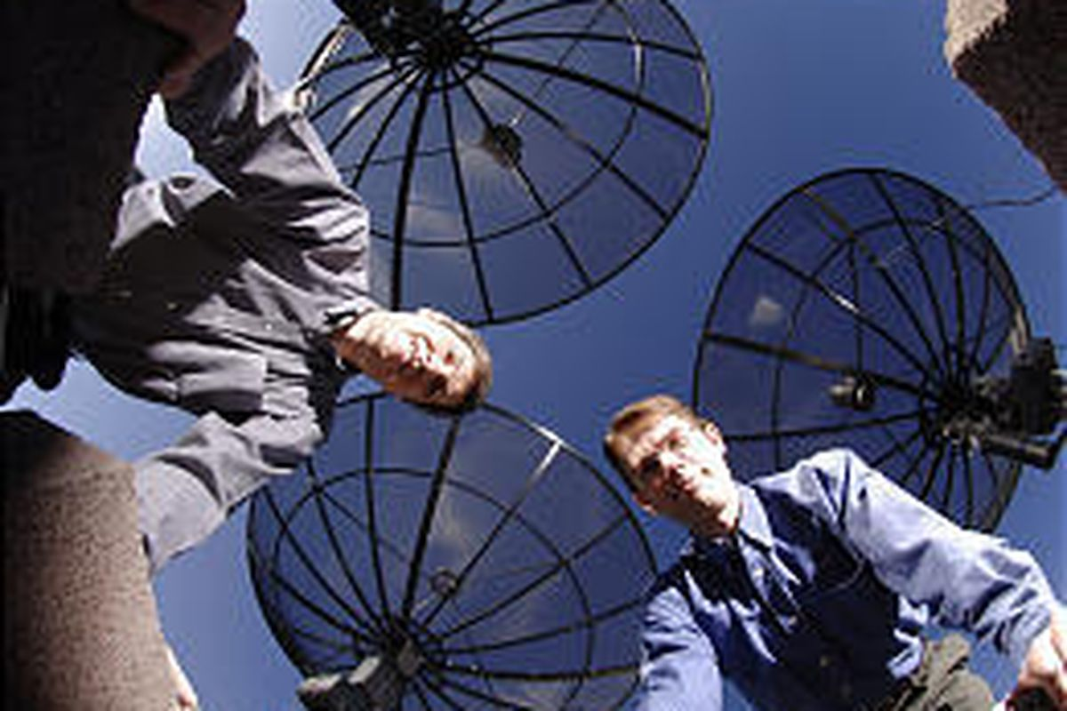 BYU professors Brian Jeffs and Karl Warnick use their small radio telescope to refine a method of reducing man-made interference and focus on distant stars.