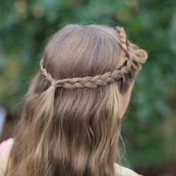"""The Cute Girls Hairstyles original Bow Braid hairstyle, as seen in """"The Hunger Games: Catching Fire."""""""