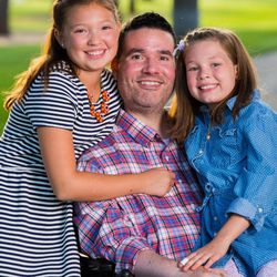 Vance Taylor poses with his daughters Isabelle, left, and Sammy, right.